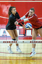 BLOOMINGTON, IL - October 23: Kaity Weimerskrch  and Sarah Kushner both after the same ball during a college Women's volleyball match between the ISU Redbirds and the Drake Buldogs on October 23 2021 at Illinois State University in Normal, IL. (Photo by Alan Look)