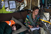 An Anti-fracking campaigner is keeping track on how far the drilling is at the Cuadrilla fracking site in New Preston Road, Lancashire, United Kingdom, June 29th 2018.  Block Around the Clock - a fourty eight hours of event with work shops, yoga, sleeping and anti-fracking campaigning in front of the gates to Cuadrillas fracking site in Lancashire. The event was organised by anti-fracking campaigners in spite of an injunction granted to Cuadrilla to prevent protest against the impending shale gas exploitation. The Cuadrilla site in Lancashire in a highly contested site, almost ready to drill for gas.