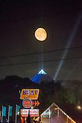 The moon rises overthe Beat Hotel and the Pyramid Stageg - The 2016 Glastonbury Festival, Worthy Farm, Glastonbury.