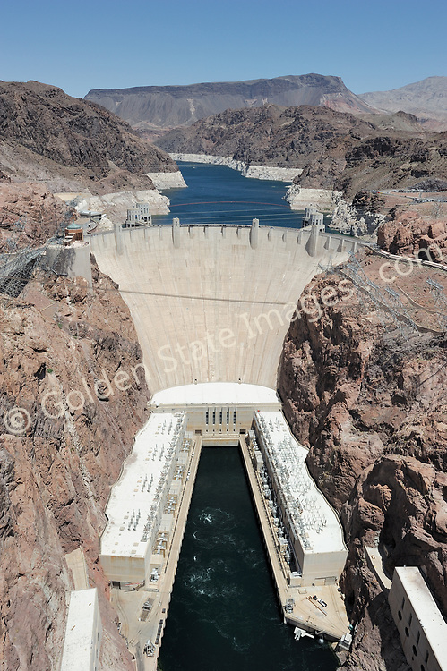 Hoover Dam Hydroelectric Power.<br /> <br /> Hoover Dam is designed to never have the water level of Lake Mead overtop the dam. There are spillways on each side which route excess storage around the dam.