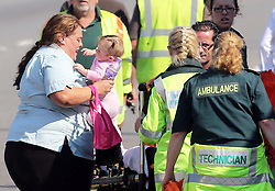 A mother and her baby are taken away from the scene of the multi car pile up on the A249 Isle of Sheppey  bridge in Kent, Thursday, 5th September 2013. Picture by Stephen Lock / i-Images