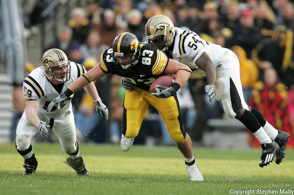 17 NOVEMBER 2007: Iowa tight end Brandon Myers (83) is hit from behind by Western Michigan defensive end Greg Marshall (54) in Western Michigan's 28-19 win over Iowa at Kinnick Stadium in Iowa City, Iowa on November 17, 2007.