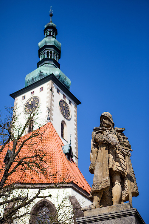 """Jan Zizka monument at the main square called """"Zizkovo Namesti"""" with """"The Church of the Transfiguration of Our Lord"""" in the back located at the South Bohemian city of Tabor. Jan Zizka z Trocnova a Kalicha (English: John Zizka of Trocnov and the Chalice) (c. 1360–1424), was a Czech general and Hussite leader, follower of Jan Hus, and born in the small village of Trocnov (now part of Borovany) in Bohemia, into a gentried family. He was nicknamed """"One-eyed Žižka."""""""