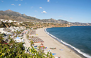 Playa Burriana sandy beach at popular holiday resort town of Nerja, Malaga province, Spain