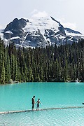 At Middle Joffre Lake, see Stonecrop Glacier on Slalok Mountain in Joffre Lakes Provincial Park of British Columbia, near Pemberton, in the Coast Range, Canada. A rough, rocky, steep hike of 10 kilometers round trip ascends (400 meters up) by a rushing stream to three beautiful turquoise lakes (colored by glacial silt reflecting green and blue sunlight).