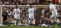 Photo: Paul Thomas.<br /> Tottenham Hotspur v Sevilla. UEFA Cup. Quarter Final, 2nd Leg. 12/04/2007.<br /> <br /> Dejected Spurs captain Ledley King (C) and team.