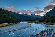 Sunset on peaks above Dart River seen from Daley's Flat Hut in Mount Aspiring National Park, Otago region, South Island of New Zealand.