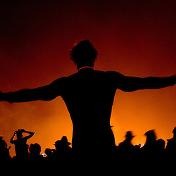 Aug. 30 2008 - Black Rock City, Nevada, USA - A festival goer dances in the glow of the fire following the burning of the Man, Saturday night, Aug. 30, 2008, during the Burning Man arts and culture festival in Black Rock City in the Black Rock Desert near Gerlach, Nev. (Credit Image: © David Calvert/ZUMA Press)