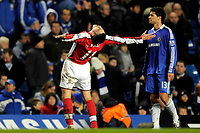 Fotball<br /> England<br /> Foto: Colorsport/Digitalsport<br /> NORWAY ONLY<br /> <br /> Robin van Persie (Arsenal) throws his arms wide and looks to the skies in celebration of the win. Michael Ballack (Chelsea) looks distraught. Chelsea Vs Arsenal. Barclays Premier League. Stamford Bridge. London. 30/11/2008.
