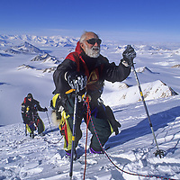 ANTARCTICA. 88-year old Norman Vaughan, exhausted, near summit of mountain named for him by Richard Byrd in 1929.