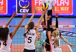 04-01-2016 TUR: European Olympic Qualification Tournament Nederland - Duitsland, Ankara <br /> De Nederlandse volleybalvrouwen hebben de eerste wedstrijd van het olympisch kwalificatietoernooi in Ankara niet kunnen winnen. Duitsland was met 3-2 te sterk (28-26, 22-25, 22-25, 25-20, 11-15) / Heike Beier #12 of Germany, Celeste Plak #4, Robin de Kruijf #5, Laura Dijkema #14