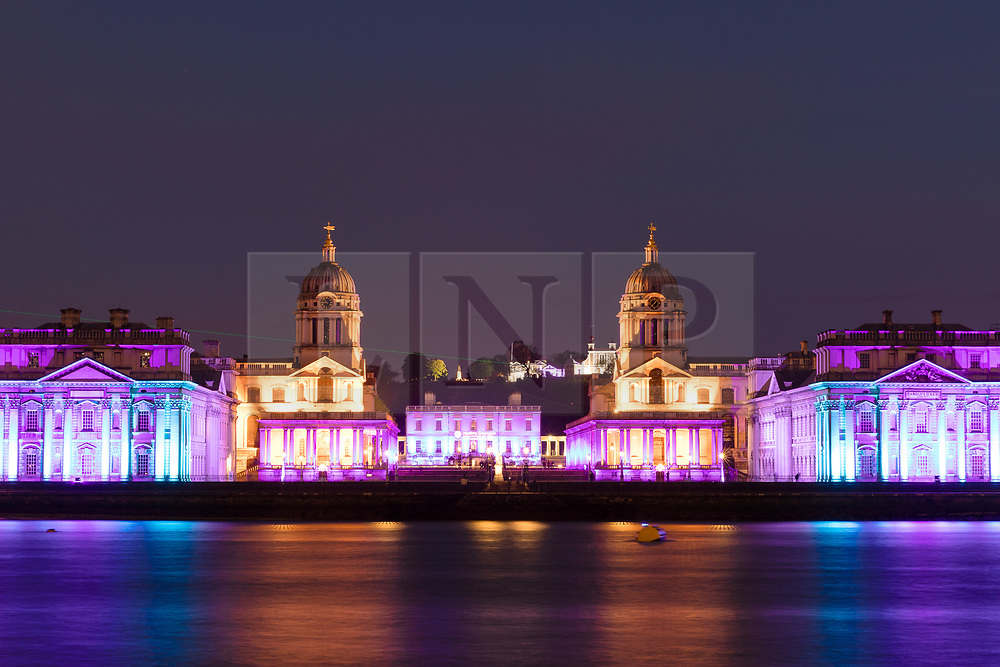© Licensed to London News Pictures. 18/04/2017. LONDON, UK.  Greenwich landmarks: the Old Royal Naval College, the Queen's House, the National Maritime Museum and the Royal Observatory are seen lit up at night across the River Thames in south east London, to mark World Heritage Day 2017, which celebrates the international day for monuments and sites. This is the 20th anniversary of Maritime Greenwich being designated as a UNESCO World Heritage Site.  Photo credit: Vickie Flores/LNP