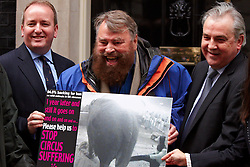 © London News Pictures. FILE PIC DATED 29/03/2011.  MP MARK PRITCHARD (left) on the step of 10 Downing Street with Actor Brian Blessed (centre),  and Jim Dowd MP (right) handing in a postcard to Downing Street calling for a ban on circus animals. MP Mark Pritchard has been arrested on suspicion of rape, and has been released on bail.. Photo credit : Cliff Hide/LNP.