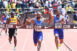 April 28, 2018 - Philadelphia, Pennsylvania, U.S - JUSTIN WALKER, of the USA, crosses the finish line first during the USA vs The World Men 4x100 at the 124th running of the Penn Relays in Philadelphia Pennsylvania (Credit Image: © Ricky Fitchett via ZUMA Wire)