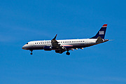 US Airway jet flying near LaGuardia Airport in New York City.