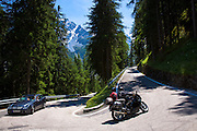 Car and motorcycle heading uphill on The Stelvio Pass, Passo dello Stelvio, Stilfser Joch, in the Alps, Italy