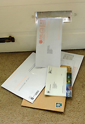 EDITORS NOTE IMAGE PIXELATED BY PA PICTURE DESK File photo dated 17/05/07 of post being delivered through a letterbox, as Royal Mail has been accused of allowing fraudulent letters to be sent en masse to vulnerable recipients.