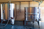 Stainless steel vats. Chateau Lapeyronie, Cotes de Castillon, Bordeaux, France