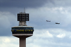 The Battle of Britain Memorial Flight passes Radio City Tower during the ninth annual Armed Forces Day in Liverpool.