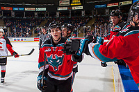KELOWNA, CANADA - OCTOBER 28: Jack Cowell #8 of the Kelowna Rockets skates past the bench and fist bumps teammates to celebrate a goal against the Prince George Cougars on October 28, 2017 at Prospera Place in Kelowna, British Columbia, Canada.  (Photo by Marissa Baecker/Shoot the Breeze)  *** Local Caption ***