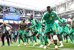 June 19, 2018- Moscow, Russia - MBAYE NIANG (front) of Senegal and his teammates celebrate victory after a Group H match between Poland and Senegal at the 2018 FIFA World Cup in Moscow. Senegal won 2-1. (Credit Image: © Xu Zijian/Xinhua via ZUMA Wire)