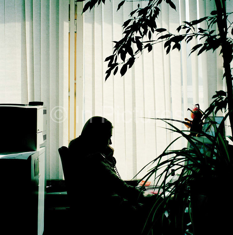 Yasmina Kalipa, sales assistant, marketing department the Moscow Times. From the series Desk Job, a project which explores globalisation through office life around the World.