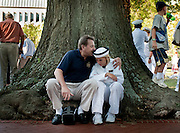 """A father and daugher share a quiet moment following her taking the oath of office at the U.S. Naval Academy in Annapolis, MD. Approximately 1,230 young men and women arrived at the U.S. Naval Academy's Alumni Hall, Thursday, July 1, for Induction Day to begin their new lives as """"plebes"""" or midshipmen fourth class (freshmen). """"I-Day"""" culminates when the members of the Class of 2014 take the oath of office at a ceremony at 6 p.m. in Tecumseh Court, the historic courtyard of the Bancroft Hall dormitory. Over 17,400 young men and women applied to be members of the Naval Academy Class of 2014 - a record for USNA."""