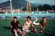 A sixties family holiday portrait at a German open-air pool, on 13th July, in North Rhine-Westphalia, Germany.