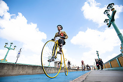 © Licensed to London News Pictures. 04/05/2019. London, UK. A man cycles his Penny Farthing bicycle across Southwark Bridge on the Tweed Run bike ride in Central London. The annual event sees hundreds of people cycle around the capital past various landmarks wearing vintage tweed outfits. Photo credit: Rob Pinney/LNP