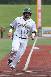 07 June 2015:  Jason Merjano trots to home on a hit by Cameron Monger during a Frontier League Baseball game between the Southern Illinois Miners and the Normal CornBelters at Corn Crib Stadium on the campus of Heartland Community College in Normal Illinois