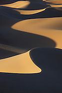 Sahara desert sand dunes with strong shadows at Erg Lihoudi, M'hamid, Morocco.