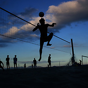 Locals play foot volley, a hybrid game combining beach volley ball and football at Copacabana beach, Rio de Janeiro,  Brazil. 5th July 2010. Photo Tim Clayton....