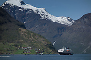 Boats, including the Hurtigruten cruise ship, navigate Geiraingerfjord  on May 18, 2013.  An overlook is along the Eagle Road, which has 11 hairpin turns. Geirangerfjord is among UNESCO World Heritage sites.  (© 2013 Cindi Christie)
