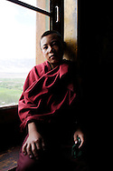 India, Ladakh. 10-years old Tenzing, young novice living in Thiksey monastery.