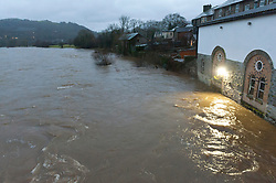 © Licensed to London News Pictures. 20/01/2021. Builth Wells, Powys, Wales, UK.  After recent heavy rainfall the river Wye bursts it's banks at Builth Wells in Powys, Wales, UK. Photo credit: Graham M. Lawrence/LNP