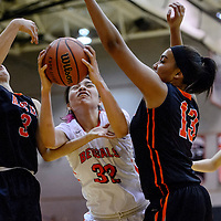Gallup Bengal Rhiannon Singer (32) fights a rebound away from Aztec Tigers Grace Olsen (3) and McKayla McCaskill (13) Thursday at Gallup High School.