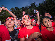 09 NOVEMBER 2015 - YANGON, MYANMAR: Men react to elections' officials announcing vote results during the victory celebration at NLD headquaters Monday. Thousands of National League for Democracy (NLD) supporters gathered at NLD headquarters on Shwegondaing Road in central Yangon to celebrate their apparent landslide victory in Myanmar's national elections that took place Sunday. The announcement of official results was delayed repeatedly Monday, but early reports are that the NLD did very well against the incumbent USDP.     PHOTO BY JACK KURTZ
