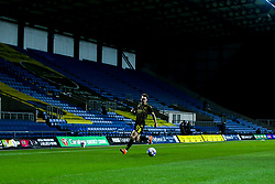 Sam Nicholson of Bristol Rovers runs with the ball in front of an empty stand at the Kassam Stadium as fans are still not allowed to attend matches due to Covid-19 - Mandatory by-line: Robbie Stephenson/JMP - 06/10/2020 - FOOTBALL - Kassam Stadium - Oxford, England - Oxford United v Bristol Rovers - Leasing.com Trophy