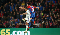 Cardiff City's Lee Peltier (left) and Crystal Palace's James Tomkins (right) battle for the ball during the Premier League match at Selhurst Park, London.