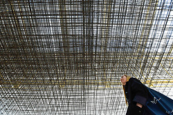"© Licensed to London News Pictures. 17/09/2019. LONDON, UK. A visitor views ""Matrix III"", 2019, by Antony Gormley, 6 tonnes of steel reinforcing mesh. Preview of a new exhibition by Antony Gormley at the Royal Academy of Arts.  The show bring together existing and specially conceived new works from drawing to sculptures to experimental environments to be displayed in all 13 rooms of the RA's Main Galleries 21 September to 3 December 2019.  Photo credit: Stephen Chung/LNP"
