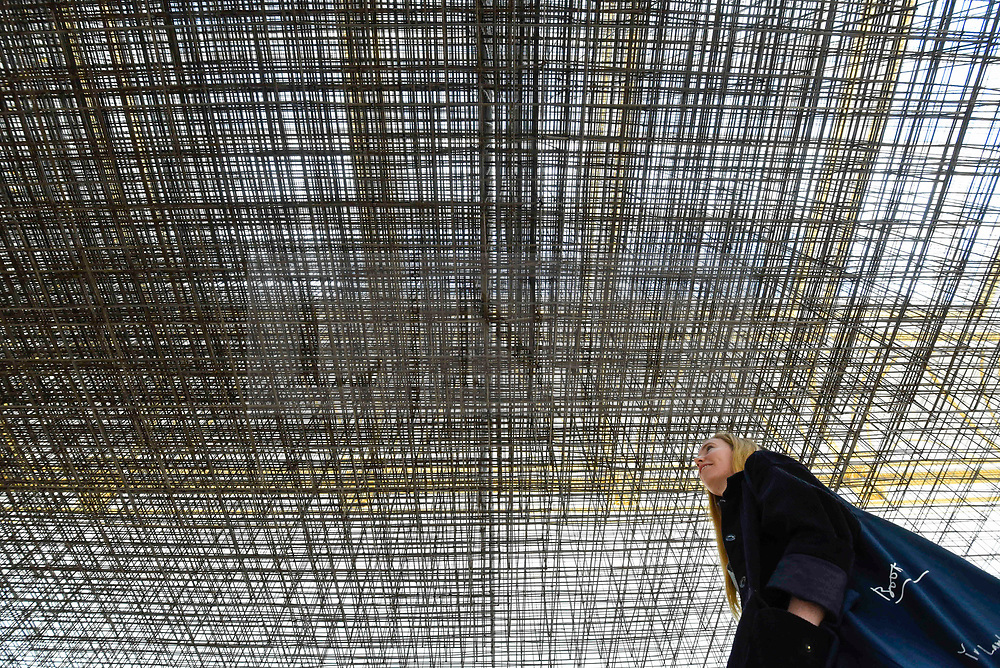 """© Licensed to London News Pictures. 17/09/2019. LONDON, UK. A visitor views """"Matrix III"""", 2019, by Antony Gormley, 6 tonnes of steel reinforcing mesh. Preview of a new exhibition by Antony Gormley at the Royal Academy of Arts.  The show bring together existing and specially conceived new works from drawing to sculptures to experimental environments to be displayed in all 13 rooms of the RA's Main Galleries 21 September to 3 December 2019.  Photo credit: Stephen Chung/LNP"""