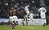 Photo: Aidan Ellis.<br /> Bolton Wanderers v Arsenal. The Barclays Premiership.<br /> 03/12/2005.<br /> Bolton's Abdoulaye Faye leaps to score the first goal with a header