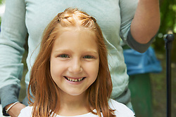 Portrait of a girl smiling with her mother in picnic, Munich, Bavaria, Germany