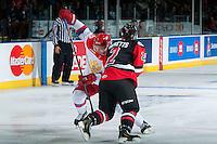 KELOWNA, CANADA - NOVEMBER 9: Joe Hicketts #2 of Team WHL checks Kirill Pilipenko #13 of Team Russia on November 9, 2015 during game 1 of the Canada Russia Super Series at Prospera Place in Kelowna, British Columbia, Canada.  (Photo by Marissa Baecker/Western Hockey League)  *** Local Caption *** Joe Hicketts; Kirill Pilipenko;