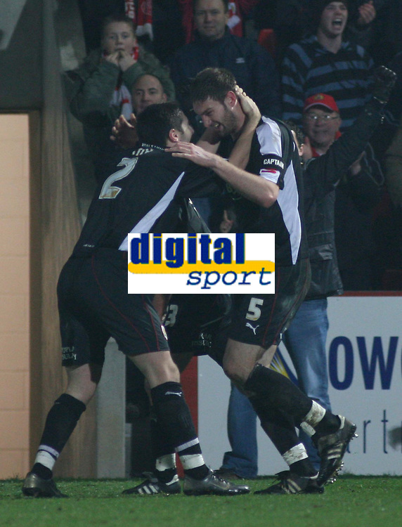 Photo: Mark Stephenson.<br />Cheltenham Town v Bristol City. Coca Cola League 1. 23/12/2006.<br />Bristol's Jamie McCombe celebrate's their first goal.