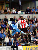 Photo: Marc Atkins.<br /> <br /> Wycombe Wanderers v Cheltenham Town. Coca Cola League 2, Play off Semi Final. 13/05/2006. Will Antwi (L) battles ion the air with Cheltenham's Kayode Odejayi (R)
