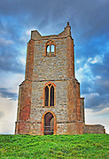 A view of the Victorian folly ruin at Burrow Mump in Somerset at dusk, after processing with HDR.