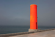 A weird landscape of the concrete, fluorescent-coloured shipping navigation marker a few hundred metres out from the beach on the artificial pier, on 18th July 2016, on Paredao da Praia da Barra, at Barra, near Aveira, Portugal. Visible to shipping many miles from the coast, the marker aides vessels to find their route from the open sea and through the narrow channel into the industrial port of Aveiro. (Photo by Richard Baker / In Pictures via Getty Images)