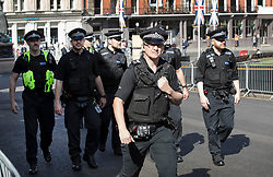 © Licensed to London News Pictures. 17/05/2018. Windsor, UK. Police gather outside Windsor Castle two days ahead of the wedding of Prince Harry and Meghan Markle. Later, a full military procession rehearsal will take place through the streets of Windsor. Photo credit: Peter Macdiarmid/LNP