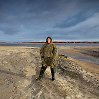 Sept 2009 Yamal Peninsula, Siberia, Russia - global warming impacts story on the Nenet people , reindeer herders in the Yamal Peninsula at a thermokarst Lake which has drained out due to the melting of the permafrost and erosion - these events will become more pre3aalent due to climate change-Andrei Yesengi - Nenet